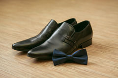 Bow tie and man's shoes. Black bow tie and black man's shoes Stock Photo