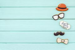 Bow tie, moustache, glasses and hat for Happy Father Day party on mint green wooden background top view copy space. Bow tie, moustache, glasses and hat for Happy stock photography