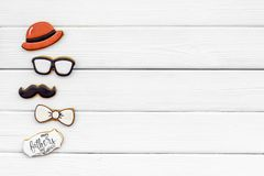 Bow tie, moustache, glasses and hat for Happy Father Day party on white wooden background top view copy space. Bow tie, moustache, glasses and hat for Happy royalty free stock photo
