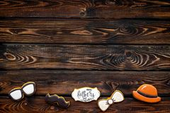 Bow tie, moustache, glasses and hat for Happy Father Day party on wooden background top view copy space.  royalty free stock photo