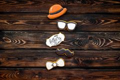 Bow tie, moustache, glasses and hat for Happy Father Day party on wooden background top view copy space stock photo