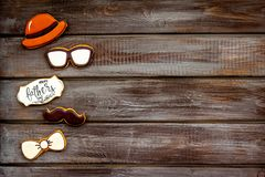 Bow tie, moustache, glasses and hat for Happy Father Day party on wooden background top view copy space. Bow tie, moustache, glasses and hat for Happy Father Day stock photography