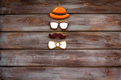 Bow tie, moustache, glasses and hat for Happy Father Day party on wooden background top view copy space. Bow tie, moustache, glasses and hat for Happy Father Day stock image