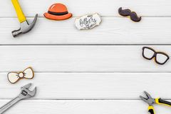 Bow tie, moustache, glasses, hat and instruments for rapair for Happy Father Day on white background top view mokeup. Bow tie, moustache, glasses, hat and stock images