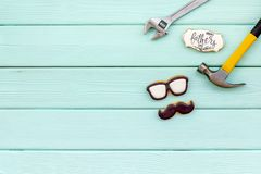 Bow tie, moustache, glasses and instruments for rapair for Happy Father Day on mint green background top view mokeup. Bow tie, moustache, glasses and instruments stock images