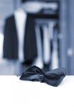 Bow tie. Open closet and tuxedo. Stock Photos
