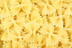 Bow tie pasta background Royalty Free Stock Images