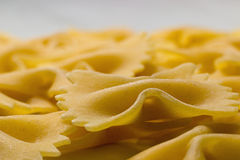 Bow tie pasta Close up. Farfalle pasta. Farfalle bows italian pasta. Farfalle - bow shaped pasta Stock Photo