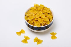 Bow tie pasta inside bowl. On white background Royalty Free Stock Image