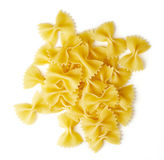 Bow tie pasta isolated on white, from above Royalty Free Stock Images