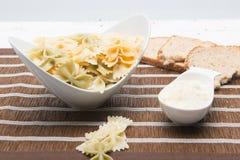 Bow tie pasta with pesto Stock Photography