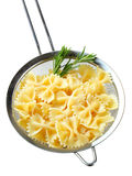 Bow tie pasta in a sieve Stock Photos