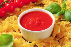 Bow tie pasta and tomato passata Royalty Free Stock Photo