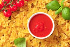Bow tie pasta and tomato passata Stock Images
