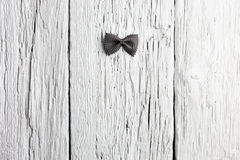 Bow tie pasta on wood Royalty Free Stock Photo