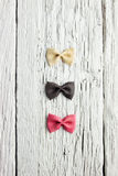 Bow tie pasta on wood Royalty Free Stock Photography