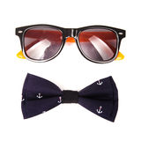 Bow tie patterned sea anchor and fashion sunglasses isolated. On white background Stock Images