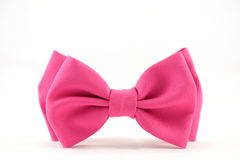 The bow tie. Pink bow tie on a white background royalty free stock photos