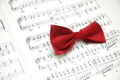 Bow tie on sheet. Of printed music stock photos