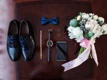 Bow tie,shoes,wedding rings ,telephone,clock,bride`s bouquet,the. Groom morning,businessman, wedding, man fashion, men`s Accessories Stock Photos