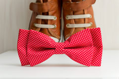 Bow tie and sneakers Stock Images