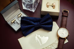 Bow tie, wedding rings in box,clock,parfumes,cufflinks,Invitatio Stock Images