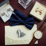 Bow tie, wedding rings in box,clock,parfumes,cufflinks,Invitatio Royalty Free Stock Photography