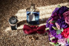 Bow tie,wedding rings ,clock,perfumes,the groom morning,business Royalty Free Stock Image