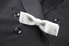 Bow tie. White bow tie and black tuxedo Royalty Free Stock Image