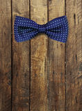 Bow tie on wooden textur Royalty Free Stock Images