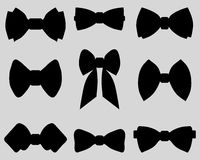 Bow ties. Black silhouettes of bow ties Royalty Free Stock Photography