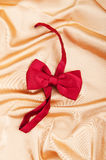 Bow ties on the bright satin Stock Image