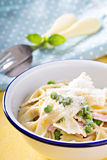 Bow ties pasta with ham and green peas Royalty Free Stock Photography
