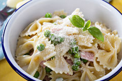 Bow ties pasta with ham and green peas Royalty Free Stock Photo