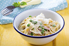 Bow ties pasta with ham and green peas Stock Photo