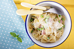 Bow ties pasta with ham and green peas Royalty Free Stock Image
