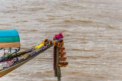 Bow of traditional longboat Thailand. Decorated bow of traditional long boat on the river in Bangkok Thailand Royalty Free Stock Photo