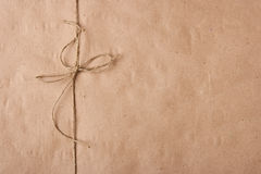 Bow from a twine on a packing paper Stock Photo