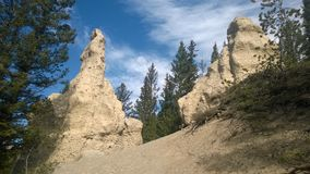 Bow valley banff  mountain hoodoo. Wet land brook fishing mountain stream valley bow river mountain path forest way river valley hoodoo hoodoos clay natural form Stock Photography