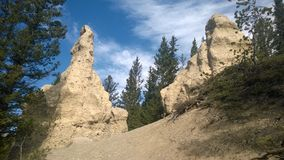Bow valley banff  mountain hoodoo. Wet land brook fishing mountain stream valley bow river mountain path forest way river valley hoodoo hoodoos clay natural form Stock Photo