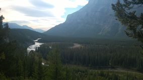 Bow valley banff  mountain. Wet land brook fishing mountain stream valley bow river tunnel mountain path forest way river valley Stock Image