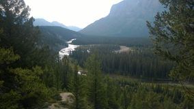 Bow valley banff  mountain. Wet land brook fishing mountain stream valley bow riverl mountain path forest way river valley Stock Images