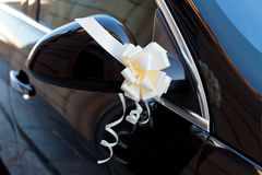 Bow on vehicle side mirror Royalty Free Stock Photos