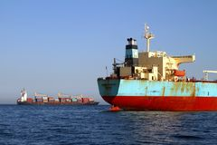 Bow view of bulk carrier ship Maersk Privilege anchored in Algeciras bay in Spain. Bulk carrier ship of Maersk company anchored and waiting for entrance in royalty free stock photos