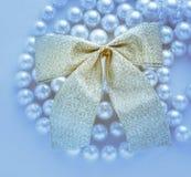 Bow on white pearl Royalty Free Stock Photos