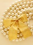 Bow on white pearl Stock Photo