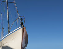 Bow of a white sailing yacht against the blue sky, generous copy Royalty Free Stock Photo