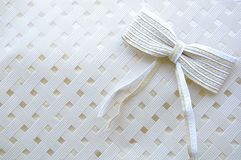 Bow on white texture Royalty Free Stock Image