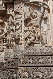Bow wielding hero. The image of mythological hero Arjuna carved on the temple wall at Halebid Royalty Free Stock Image