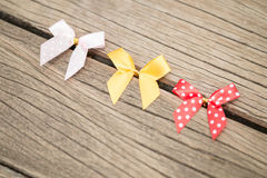 Bow on wood background. Three bow on wood background Stock Photo